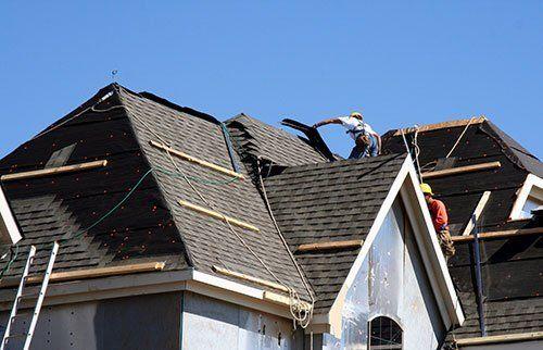 Ackmen Construction installing a roof