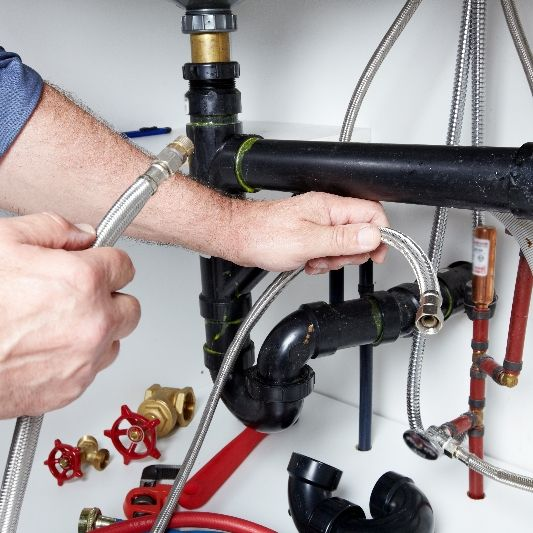 Performing plumbing services