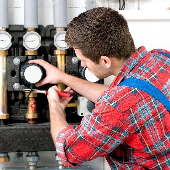Heating expert doing repairs