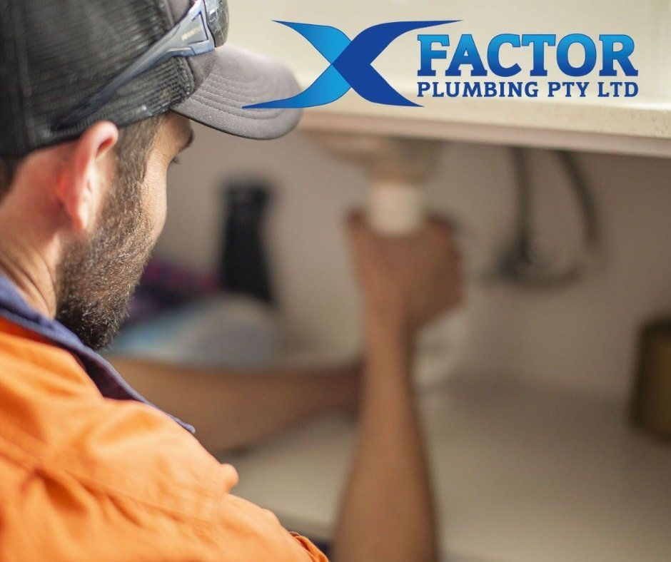 Plumber Fixing Under a Sink
