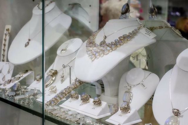 Necklaces and pendants displayed in a glass cabinet