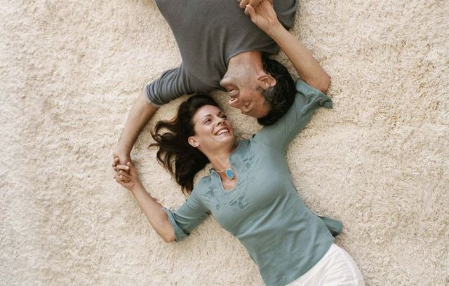 Couple on carpet after stain removal in Tauranga