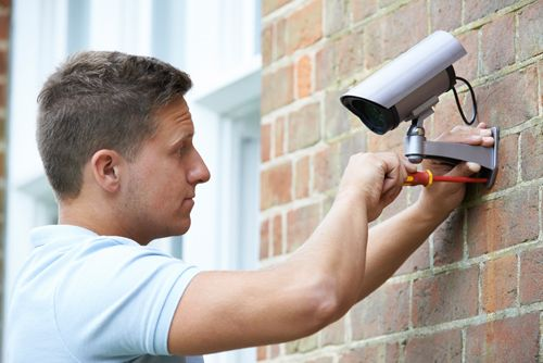 Security expert installing CCTV camera