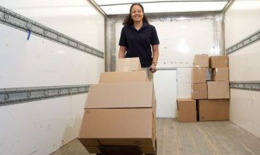 A woman unloading boxes into a safe storage unit in Columbia, MO
