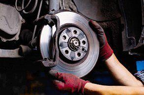 an expert repairing the brake