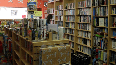 Interior of our shops, with shelves of books and gifts