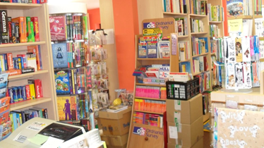 Bright welcoming corner with books on shelves and a photocopier