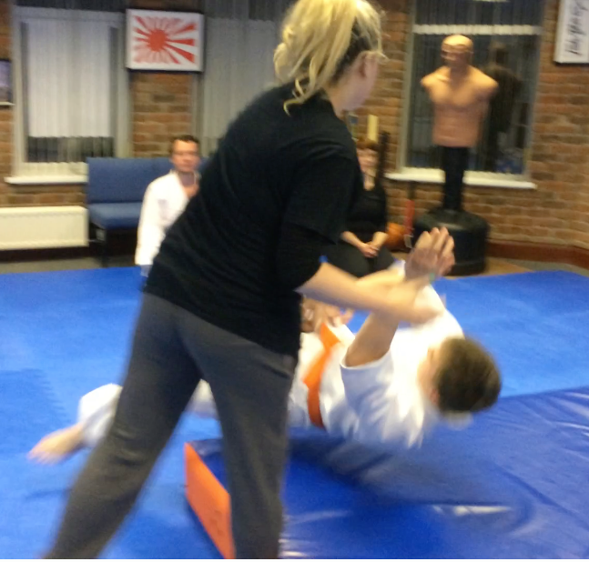 8 week Self-defence class for women. Young girls learning to throw attacker. Martin Acton's Aikido Institute