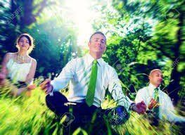 Two businessmen and lady sitting in forest visualising what they want. Martin Acton's Aikido Institute