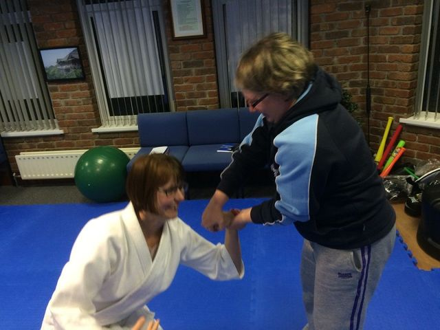 Self defence classes. two women practicing a wrist lock to restrain an attacker. Martin Acton's Aikido Institute