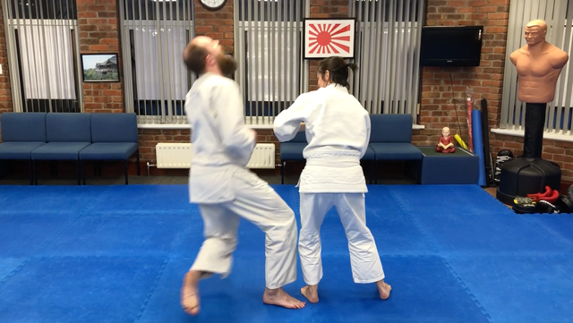 Two Aikido  students practicing technique to bring  an attacker down using his arm. Martin Acton's Aikido Institute
