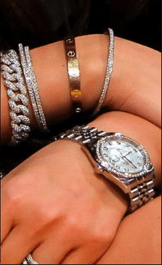 A lady wearing rings watch and bracelets. Martin Acton's Aikido Institute