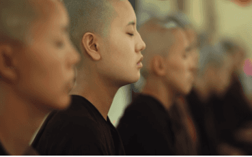 This is a photo of a Japanese female monks  practicing meditation as part of their daily life. Martin Acton's Aikido Institute