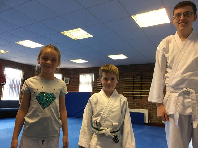 Three students that attended the Aikido 8-DAY SUMMER CAMP at Martin Acton's Aikido Institute