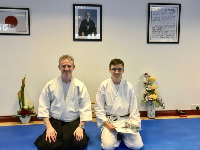 Martin Acton and his student Joshua taking a photo of Josua getting his Green Belt certification Martin Acton's Aikido Institute