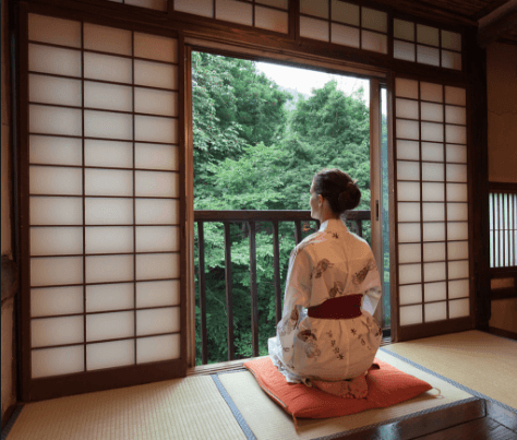 A lady sitting looking out the window Meditating. Martin Acton's  Aikido Institute