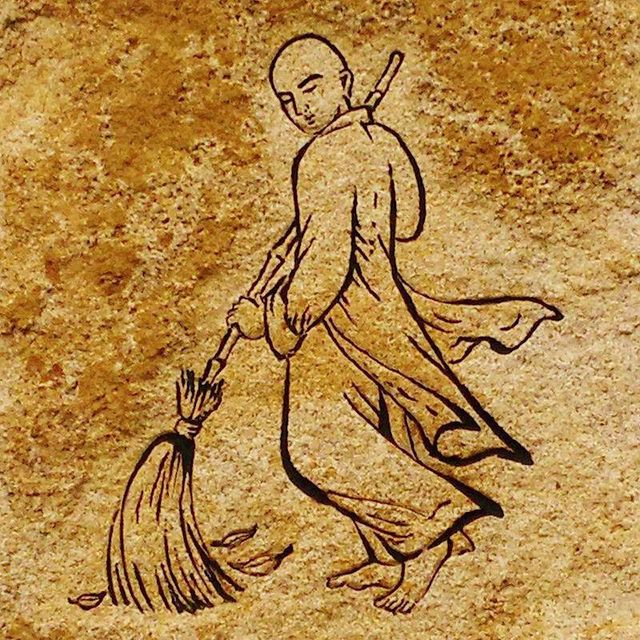 This is a poster of a monk brushing leaves . Martin Acton's Aikido Institute