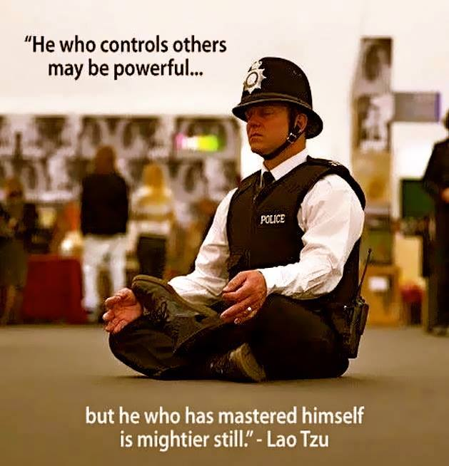 This is a poster of a policeman meditating. Martin Acton's Aikido Institute