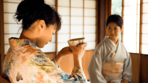 Young Japanese lady drinking tea at tea ceremony using Mindfulness. Martin Acton's Aikido Institute