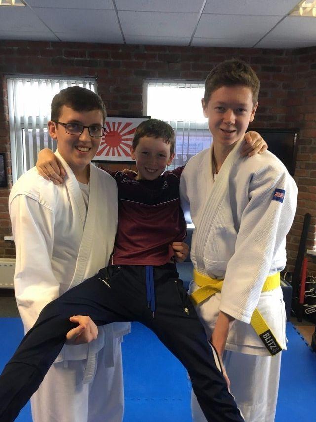 Martin Acton sensei with Philip Shields. Giving Philip his certificate for passing his grade. Martin Acton's Aikido Institute