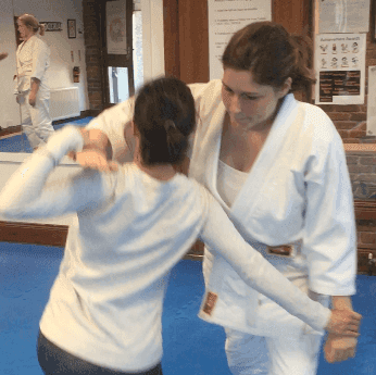 Two students practicing technique to bring  an attacker dow using his arm arm. Martin Acton's Aikido Institute