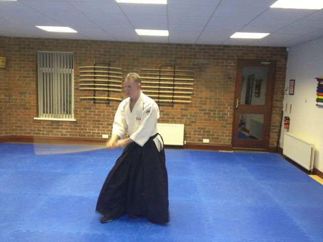 Bokken training. Martin Acton doing a cutting technique with a wooden Japanese sword. Martin Acton's Aikido Institute