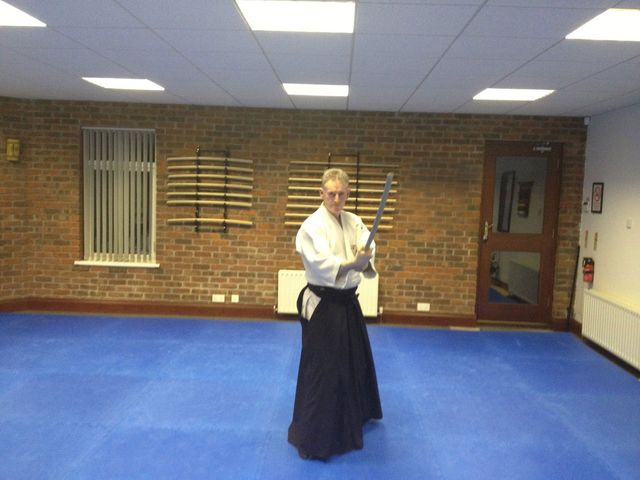 Bokken course. Martin acton sensei performing a move with wooden Japanese sword. Martin Acton's Aikido Institute