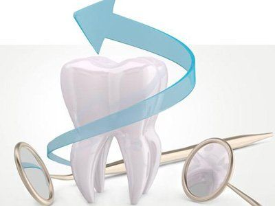 dente con immagine di una freccia e specchietti del dentista