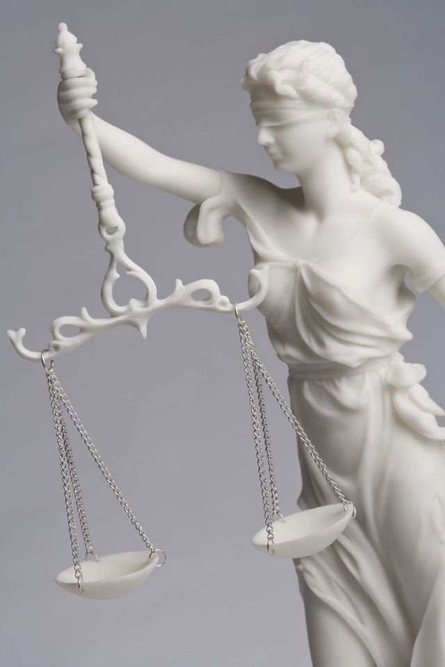 Symbol of legal issues in Elberta, AL