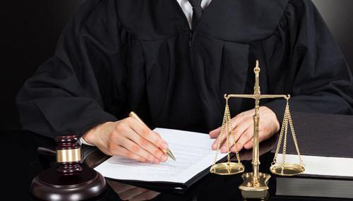 Judge writing judgement for legal cases in Central Nebraska