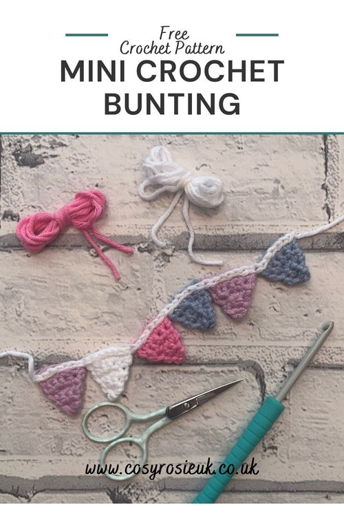 A mini bunting flat lay with crochet hook, scissors, and string shaped like bows laying nearby.