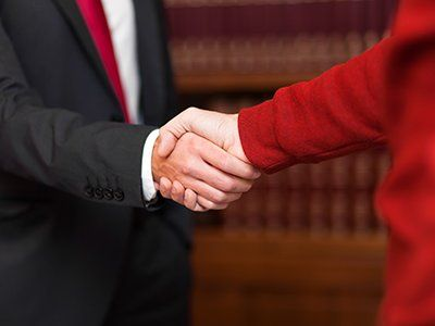 Lawyer giving an handshake to a client