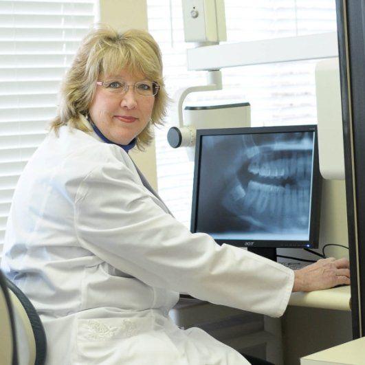 dentist examining looking at x-rays