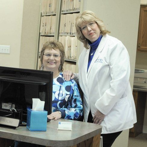 Dentist and receptionist at our office in Trussville, AL