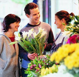 people holding bouquet of flowers