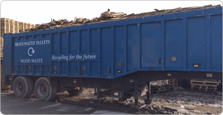 A recyclign BWP truck with wood waste in it