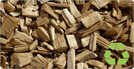 Wood chips that can be reused with a green recycling logo in the corner