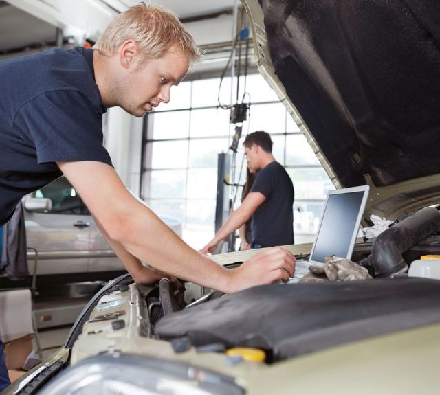 Mechanics work with motor parts in Anchorage, AK