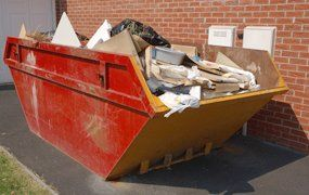 red and yellow coloured skip