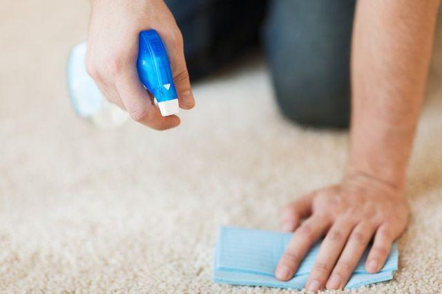 Scrubbing a tough dirt spot on carpet