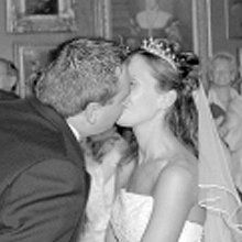 couple kissing at their wedding