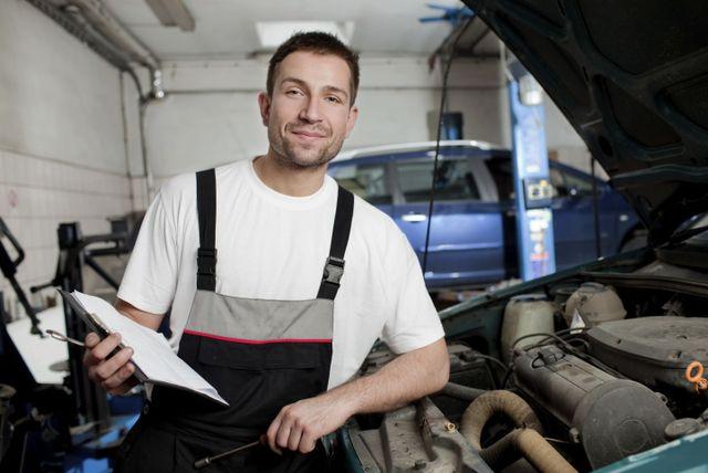 mechanic in body repair shop
