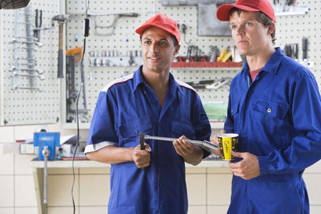team of mechanics in boy repair shop
