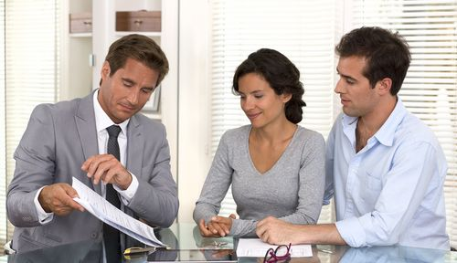 Certified Senior Insurance Advisor consulting with two potential clients