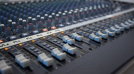 Close up of a mixing console