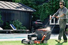 A man mowing a lawn
