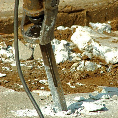Concrete being broken