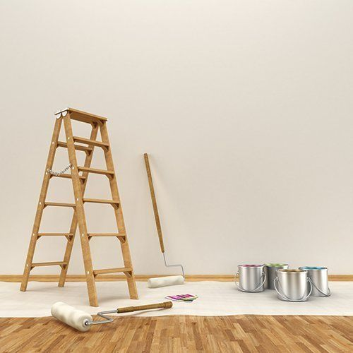 A ladder in a room being decorated