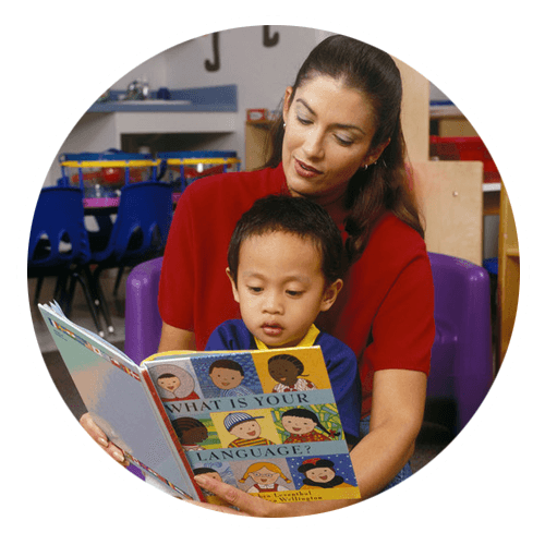 Teacher reading with a child