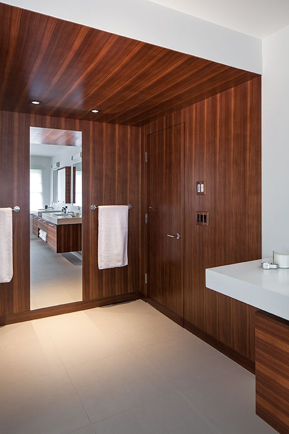 Modern residential architecture. Walnut paneled entry area to the master bathroom.